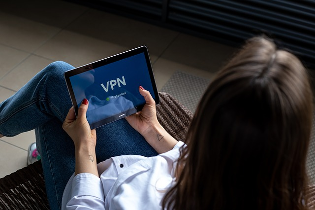 lady using free VPN account from tablet